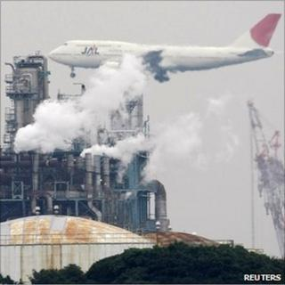 Aeroplane over factory