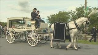 Horse-drawn funeral carriage