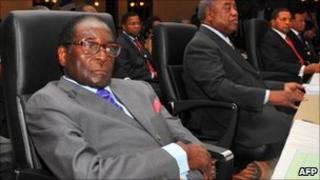 Zimbabwe's President Robert Mugabe (C) attends the opening session of a Sadc summit on 20 May 2011