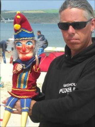 Mark Poulton and Mr Punch on the beach