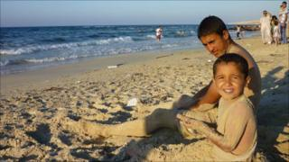 Children by the seaside in Misrata