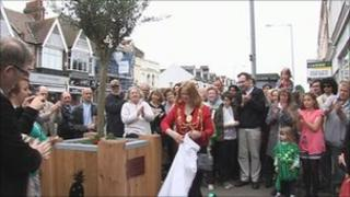 Friends unveil the olive tree outside Mr Magdi's shop in Hove
