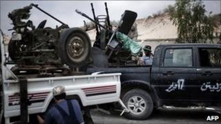 Libyan mechanics work on trucks to be used as weaponry in the rebel-held port of Misrata June 26, 2011