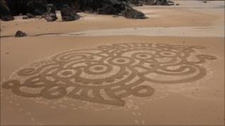 Sand sculpture of a polar bear