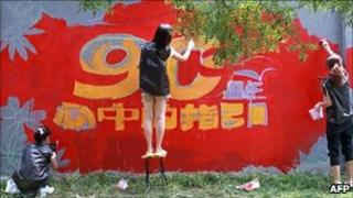 Students paint a celebratory mural in Beijing, China (26 June 2011)