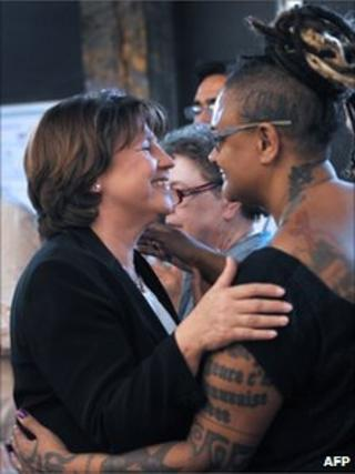 Martine Aubry (left) is congratulated by a party activist in Lille, 28 June