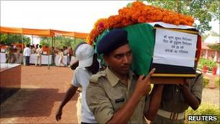 Policemen carry the flag-draped coffin of a colleague killed in Chhattisgarh