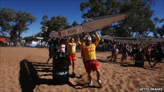 Competitors take part in the 48th Henley-on-Todd Dry Riverbed Regatta on August 22, 2009 in Alice Springs, Australia