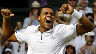 Jo-Wilfried Tsonga celebrates beating Roger Federer at Wimbledon