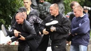 Plain-clothes police arrest a protester in Minsk, 29 June 2011