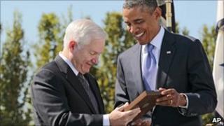 President Barack Obama handing Robert Gates the Medal of Freedom