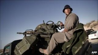 A Libyan rebel controls an anti-aircraft machine-gun on the outskirts of Misrata on 30 June
