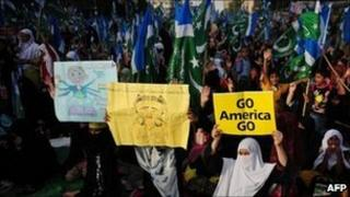 Activists of Jamaat-e-Islami Pakistan hold anti-US placards on the second of a rally in Karachi on June 5, 2011
