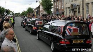 Crowds line the streets in Wootton Bassett to pay their respects