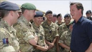 David Cameron talking to soldiers during a visit to Camp Bastion
