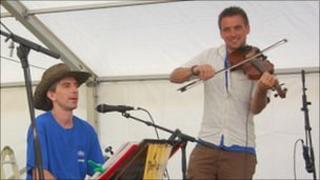 Simon Harvey (right) performing at the 2011 Sark Folk Festival
