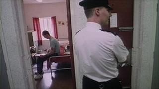 Prisoner and prison officer in a jail
