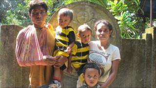 Yetriana and Mulyono Lopez with their three children