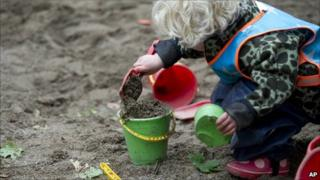 Child plays outside at Egalia pre-school in Stockholm