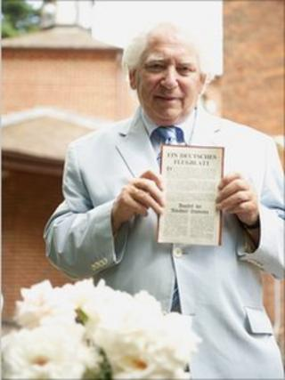 William Kaczynski holds a rare White Rose leaflet in the grounds of the Beth Shalom Holocaust Centre in Laxton, Nottinghamshire