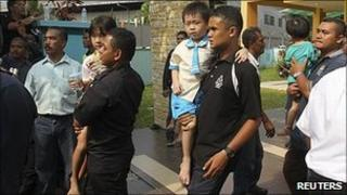 Police carry the children to safety