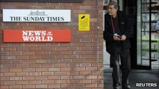 A security guard stands at the entrance to News International offices in Wapping