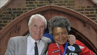 Former QPR footballer Stan Bowles with a local resident