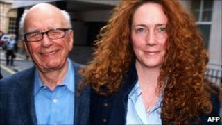 Rebekah Brooks and Rupert Murdoch leave from his London residence