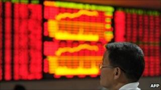 Chinese investor checks share prices