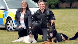 Maggie Gwynne and dog handler PC Steve Cartlidge show off Jasper and Echo