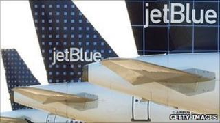 The tails of three JetBlue planes