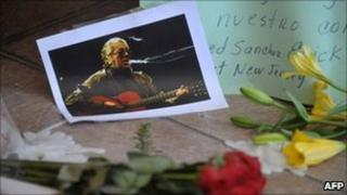 A picture of Argentine singer and songwriter Facundo Cabral remains in an altar on July 11, 2011, outside a funeral home in Guatemala City