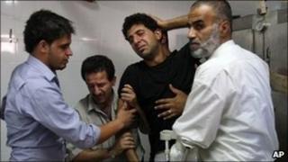 Friends and relatives of Ibrahim Sarhan at the morgue in Rafidiya Hospital, Nablus, 13 July