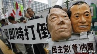Masks resembling Prime Minister Naoto Kan (R) and Ichiro Ozawa during a protest against Kan and his cabinet in Tokyo June 1, 2011