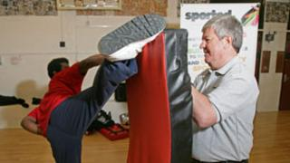 Sir Keith Mills at a kickboxing school supported by Sported