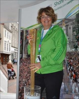 Jayne Rowley-Evans with the Olympic torch