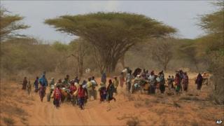 Somalis walk down the main road leading to the refugee camps around Dadaab, Kenya (13 July 2011)
