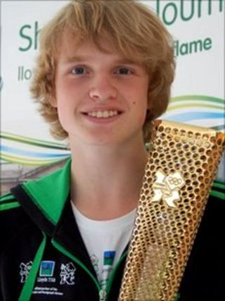 Eddie Graver with the Olympic torch prototype