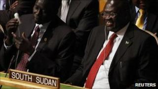 South Sudan's Vice President Riek Machar smiles with delegates after the United Nations General Assembly voted on South Sudan's membership to the United Nations at the UN. headquarters in New York July 14, 2011