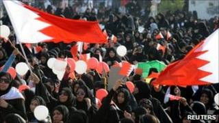 Thousands of anti-government female protesters shout anti-government slogans during a gathering held in the village of Bilad al-Qadeem, south of Manama, by opposition party al-Wifaq, 15 July 2011