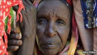 """A newly-arrived refugee waits for registration outside at Dadaab camp, near Kenya""""s border with Somalia, July 16, 2011"""