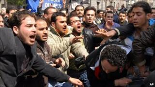 A clash between anti-government activists (left) and pro-Assad supporters (right) - file picture from March 2011