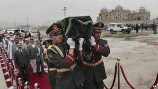 """Afghan army soldiers carry coffin of Mohammed Ashim Watanwal who was killed by armed gunmen during Sunday""""s attack, during his funeral procession in Kabul, Afghanistan, Monday, July 18, 2011"""