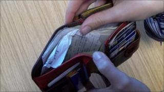 wallet with bills and credit cards