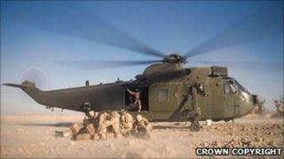A Royal Navy Sea King assists troops on the ground in Afghanistan