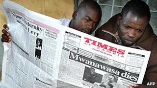 Newspaper readers in Zambia