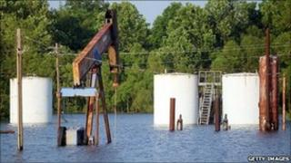 A flooded field with an oil well