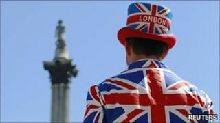 A man wears a jacket and hat displaying the Union Flag