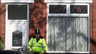 Police guard the house in Ethel Avenue