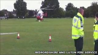 The air ambulance helicopter at the scene of the fire